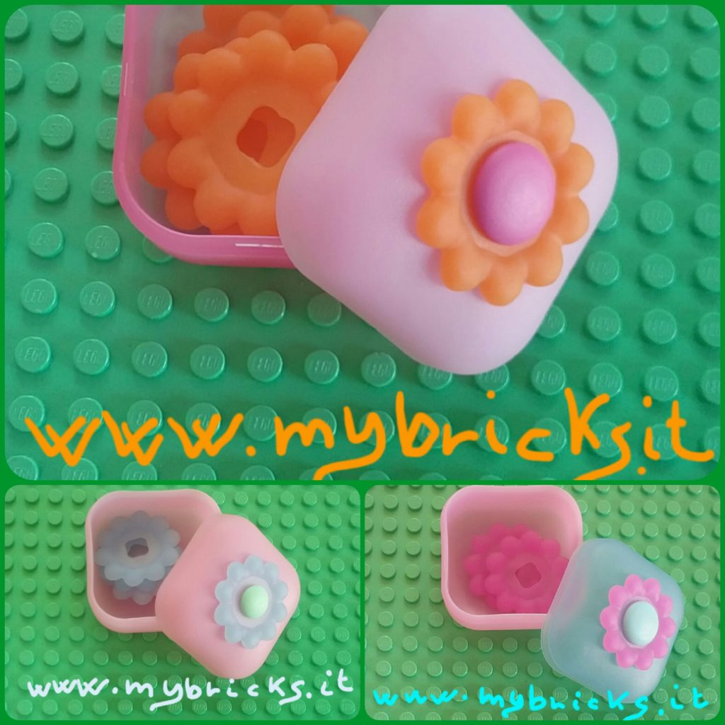 Lego Clickits Square container Box Flower - 1 Hole Pink (bottom) and Light pink (lid) - Lego Clickits Orange flexy film, Flower 10 petals 4x4 with raised border - Lego Clickits Magenta icon, Round 2x2 large with pin Lego Clickits Square container Box Flower - 1 Hole light Pink (bottom) and Light pink (lid) - Lego Clickits light blue flexy film, Flower 10 petals 4x4 with raised border - Lego Clickits Acqua icon, Round 2x2 thin with pin Lego Clickits Square container Box Flower- 1 Hole light Pink (bottom) and Light blue (lid) - Lego Clickits Magenta flexy film, Flower 10 petals 4x4 with raised border - Lego Clickits Acqua icon, Round 2x2 large with pin