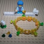 Yellow Lego bracelet with diamonds